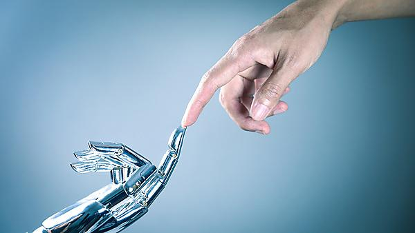 <p>Human and robot hand connecting<br></p>