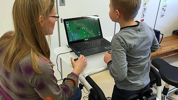 A child using the dynamic interactive trainer