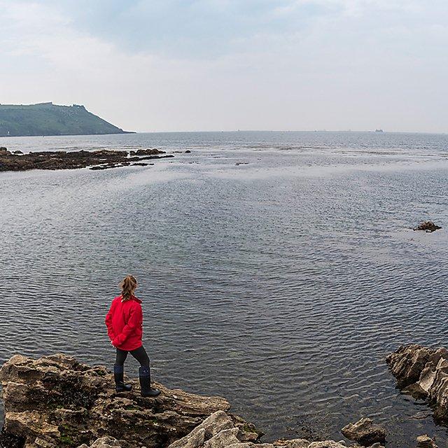 <p>Jordan standing on rocks<br></p>