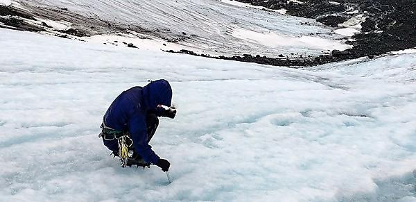 <p>Dr Caroline Clason taking ice samples for analysis</p>