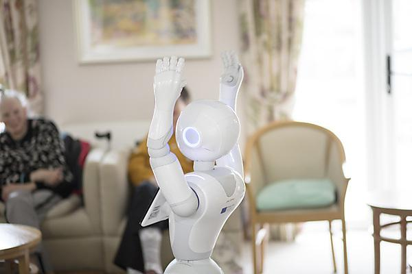 <p>Pepper entertaining residents at a care home</p>
