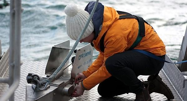 <p>Dr Clare Ostle prepares to deploy the Continuous Plankton Recorder (Image: Marine Biological Association)</p>