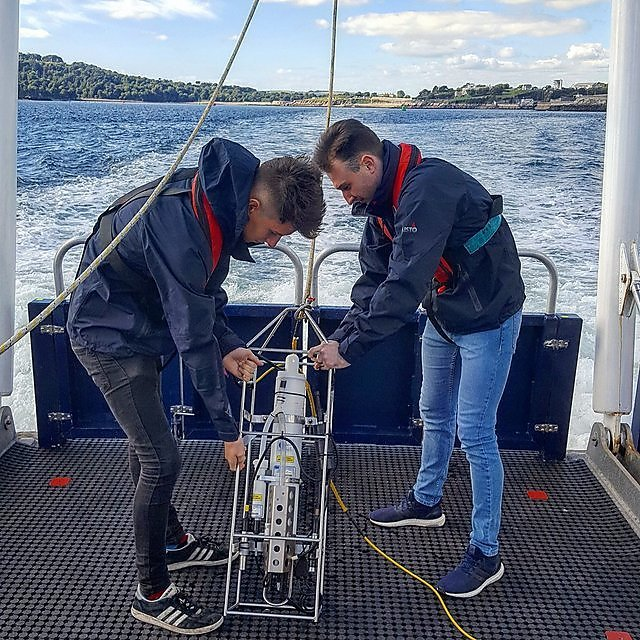 <p>Students using equipment on board Falcon Spirit</p>
