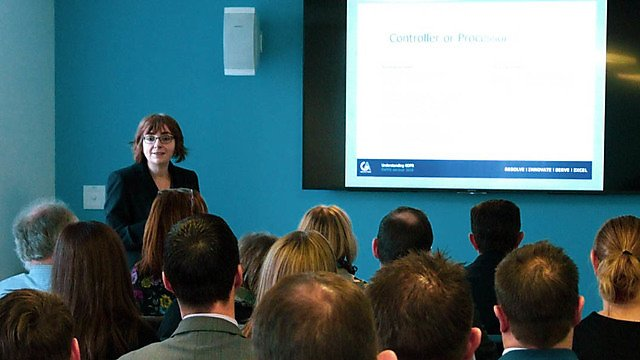 <p>Donna Butler, Gill Akaster Solicitors, presenting a seminar</p>