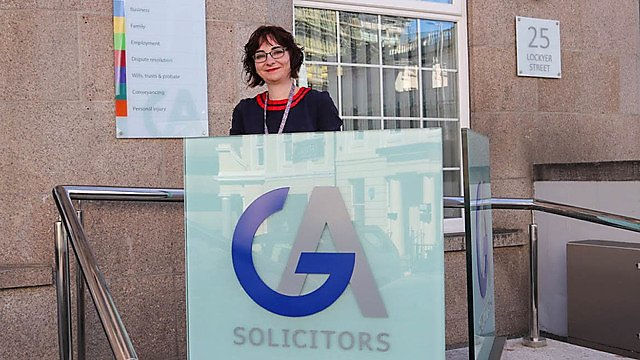 <p>Donna Butler, Gill Akaster Solicitors, outside their offices<br></p>