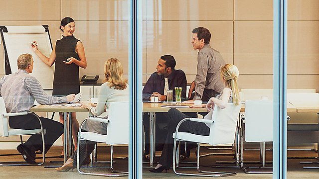 <p>Businesspeople having meeting in conference room.<br></p>