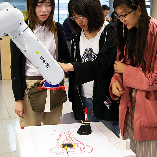 <p>SoADA Summer School students with tech in Digital Fab Lab<br></p>