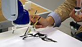 Epson Robotic Arm painting in the Digital Fabrication Laboratory