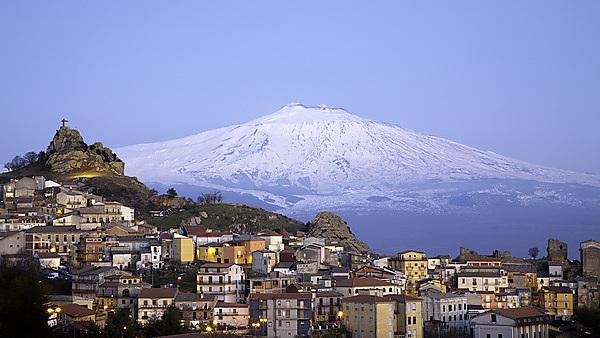 <p>View of the village of San Teodoro and Etna volcano on background. Sicily, Italy.<br></p>