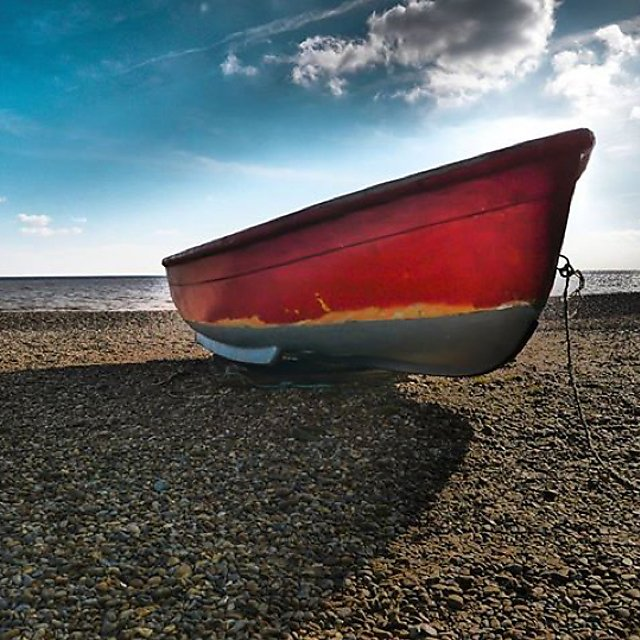 <p>Close-up of a boat on a beach,</p>