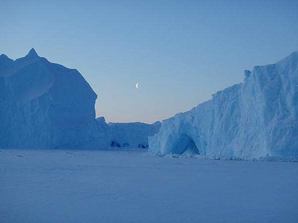 Large icebergs frozen in place by the sea ice during winter.