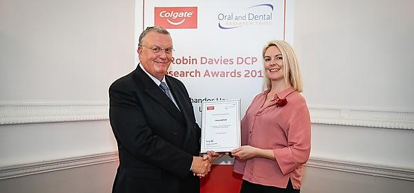 <p>Dr Louise Belfield receives&nbsp;a Colgate Robin Davies Dental Care