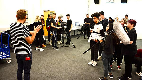 <p>Filmmamking students being taught</p>