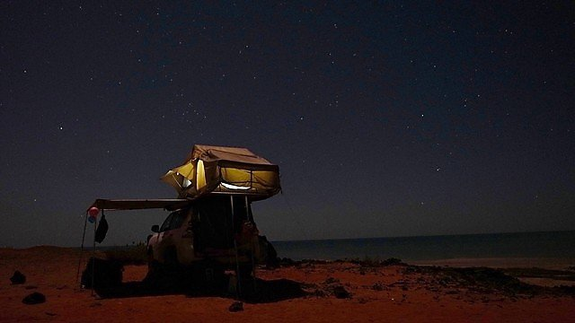 <p>Lucy Obolensky camping in the outback</p>