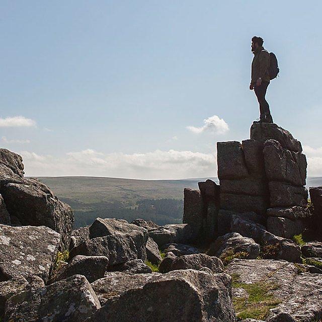 <p>Man stood on a rock on Dartmoor.&nbsp;</p>