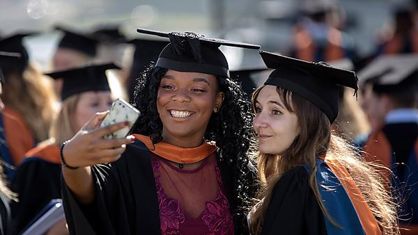 <p>Students at Graduation for Santander Scholarships</p>