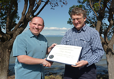 Being awarded the EAA by Prof. David Schoellhamer on the shores of South San Francisco Bay, California