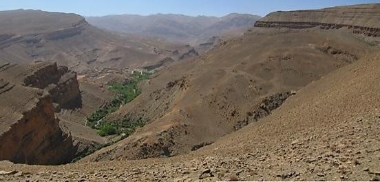 Landslide (right-hand side of valley) above agricultural fields and village in the High Atlas Mountains.