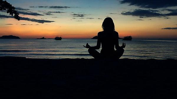 <p>meditation yoga at sunset&nbsp;</p>