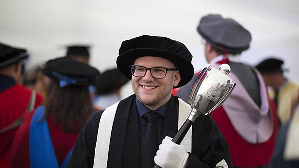 <p>Mace bearer at a graduation ceremony</p>