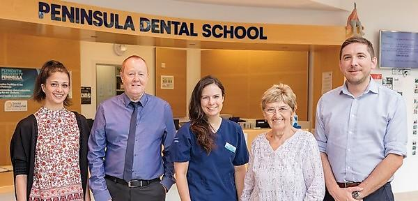 <p>The team behind PDSE's community clinic including dentist Christina Worle, centre and PDSE Director Rob Witton, right.</p>