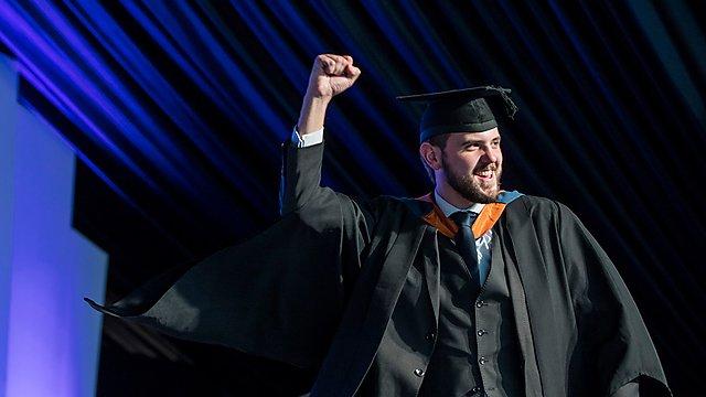 <p>Graduate celebrating</p>
