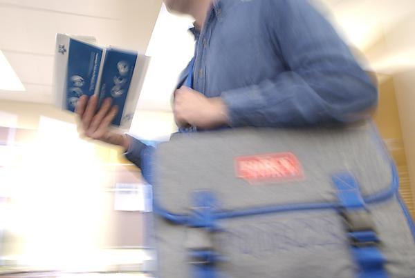 Person walking through airport departure lounge