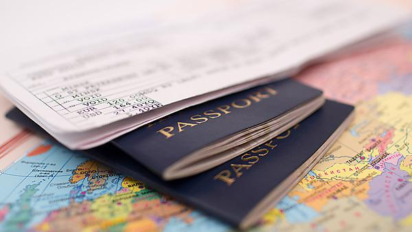 Passport and map, courtesy of Shutterstock