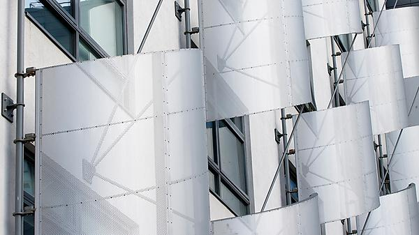 Adaptive/Intelligent Glass Materials for Tall Buildings