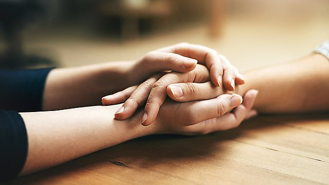 <p>Small gestures of kindness go a long way - closeup shot of two unidentifiable people holding hands in comfort. Credit: PeopleImages.<br></p>