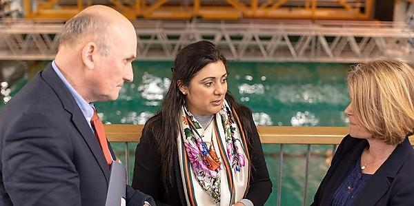 <p>Nusrat Ghani MP talks to Professor Richard Thompson OBE and Professor Deborah Greaves OBE in the COAST Laboratory</p>