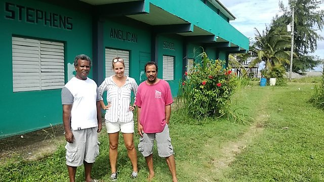<p>Dr Emma Rendle with local officials in Monkey River, Belize, standing outside a sea level rise threatened school (Credit Emma Rendle)<br></p>