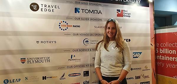 Dr Emma Rendle in front of the eXXpedition CIC sponsors board at the London launch event (Credit Emma Rendle)