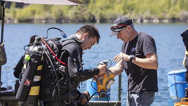 <p>De-kitting a diver post dive</p>