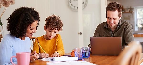 <p>Father Works On Laptop As Mother Helps Son With Homework On Kitchen Table, credit&nbsp;Credit:<br>monkeybusinessimages. GettyImages-1154944719<br></p>