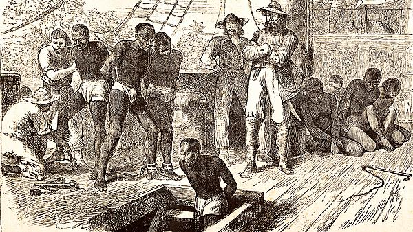 A steel engraving from 1881 illustrating black slaves being loaded onto a ship.