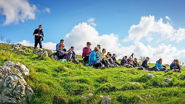 <p>Geography accreditation. Students on fieldwork in the sun</p>