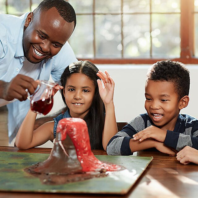 <p>Family doing a science experiment, baking soda volcano.</p>