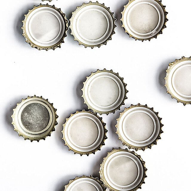 <p>Bottle tops on white background square</p>