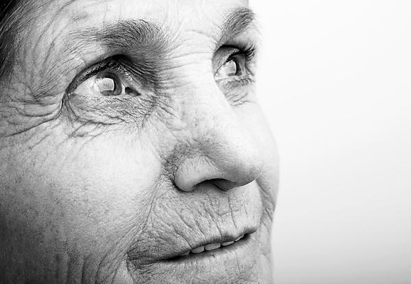 <p>Elderly woman looking hopeful</p>
