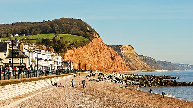 <p>Sidmouth seafront with red cliffs of Jurassic Coast</p>