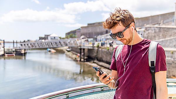 <p>Man using Plymouth Trails app</p>