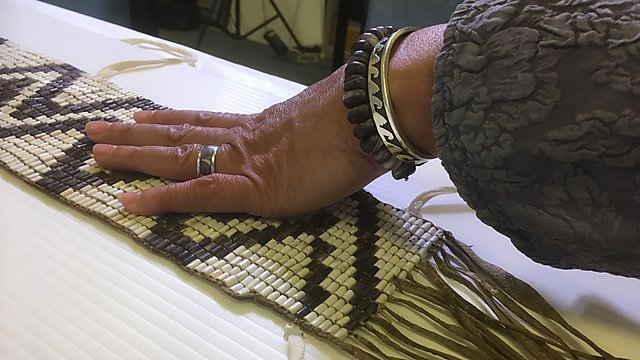 <p>Wampum and hands<br></p>