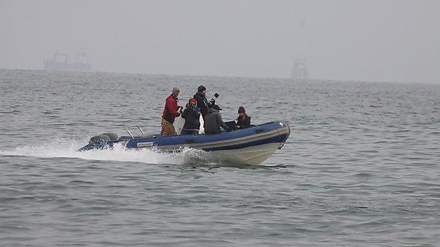 <p>Emma Longden capturing dolphin data</p>