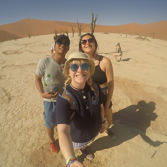<p>Emma&nbsp;Longden and colleagues at the red dunes of Sossusvlei in&nbsp;Namibia.</p>