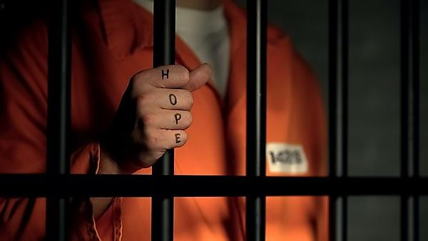<p>Hope word on imprisoned man fingers, holding jail bars, dream about freedom - stock photo<br></p>