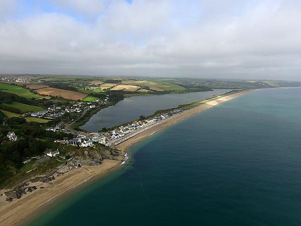 <p>Slapton Sands, with the village of Torcross in the foreground, is an example of where the beach has space to move and therefore survive<br></p>