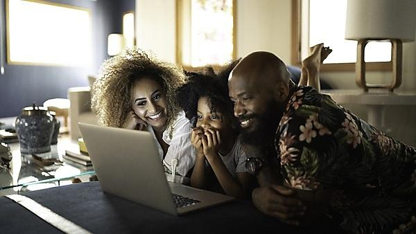 <p>Happy family watching movie on a laptop<br></p>