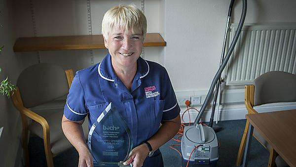 Grace Harrison with her Cleaning Operative of the Year 2014 award