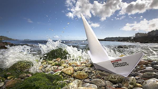 Paper boat with pioneer with Plymouth University